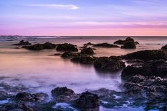 Tide pools at sunset; Pacific Ocean coastline, California;. Long exposure stock photography