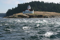Tide rips at Patos Lighthouse. Photograph of the tide rips in front of the lighthouse on Patos Island, Washington.  Photo taken from a sailboat passing the Royalty Free Stock Images