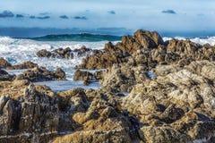 Tide Rolling In. Along The Coast on Monterey Peninsula California. Waves crashing into the Rocks Stock Photo