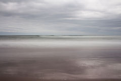Tide rolling in softly. Tide rolling in to beach softly Stock Photography