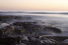 Tide Tables. At a Southern California beach at sunset Royalty Free Stock Photo