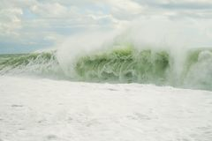 The tide wave with foam Royalty Free Stock Photography