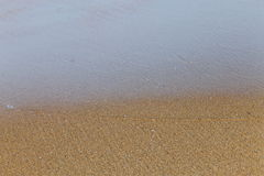 Tide withdraw from sea shore. Tide or wave retreat from beach exposing the sand texture Stock Photography