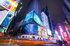 Tider kvadrerar på natten fotografering för bildbyråer