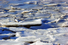 Tides breaking ice shoreline Royalty Free Stock Photography