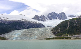 Tidewater Glacier and Dramatic Peaks Royalty Free Stock Photo