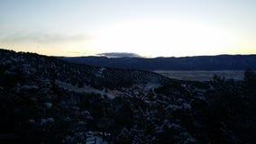 Tidig gryning i bergen Arkivbilder