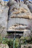 Tidigt medeltida vaggar den lättnadsMadara ryttaren från perioden av första bulgariska välde, listan för UNESCOvärldsarvet, den S Arkivfoton