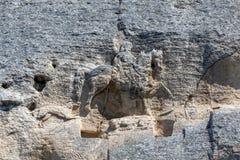 Tidigt medeltida vaggar den lättnadsMadara ryttaren från perioden av första bulgariska välde, listan för UNESCOvärldsarvet, den S Royaltyfria Bilder