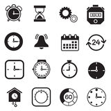 Tidmätare, klocka och klockasymboler Arkivfoto