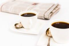 Tidning och kaffe Fotografering för Bildbyråer