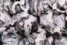 Tidningar vikta för att bilda en bakgrund Royaltyfria Bilder