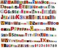 Tidningsalfabet med bokstäver och nummer royaltyfria bilder