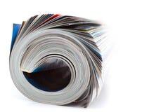 tidskriften rullade Arkivfoton