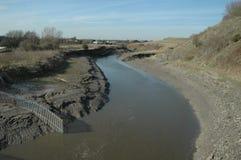 tidvattens- bred flodmynning arkivbilder