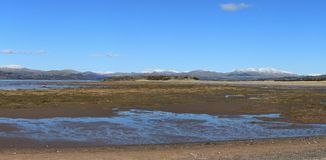 Tidvattens- bred flodmynning England Cumbria Arkivfoton
