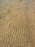 Tidvattensströmsand arkivfoto