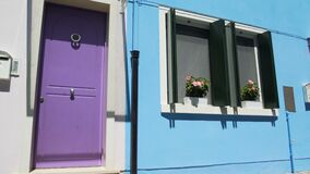 Tidy mail boxes hanging near brightly painted doors of vivid colorful houses. Stock footage stock footage