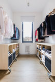Tidy spacious closet. With wooden floor in big house stock photography