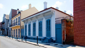 Tidy street in New Orleans. A neat row of houses in a street in the French Quarter of New Orleans, Louisiana, USA with a variety of colours and styles of royalty free stock photo