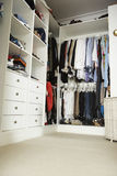 Tidy Teenage Bedroom With Neat Wardrobe Royalty Free Stock Images