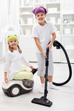 Tidy up day - children cleaning their room Stock Photo