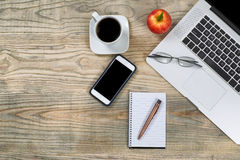 Tidy workspace with red apple and coffee for break Stock Image
