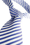 Tie. White blue tie and white background stock image