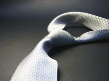 Tie 12. Silver tie on the black shadow background Royalty Free Stock Image