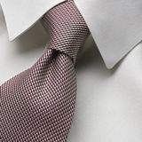 Tie. White collar with neatly tied necktie - four in hand knot Royalty Free Stock Photo