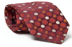Tie. A red patterned silk tie Royalty Free Stock Photos
