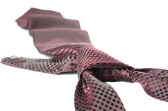 Tie. Burgundy doted tie with a knot Royalty Free Stock Image