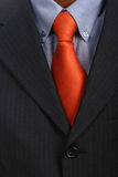 Tie. Detail of a Business man Suit with red tie Royalty Free Stock Image