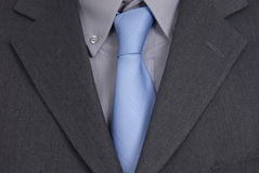 Tie. Detail of a Business man Suit with blue tie Royalty Free Stock Photos