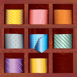 Tie. A set of ties folded in the wood shelves Stock Images