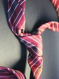 Tie 4. Red striped tie on the black shadow background Stock Photo