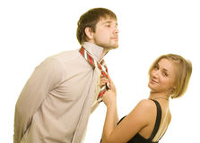 Tie. Young pair. Woman helps fasten a tie stock images