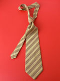 Tie. Yellow tie on red background Royalty Free Stock Photography