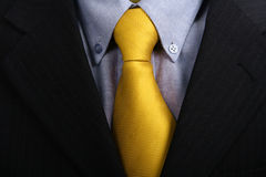 Tie. Detail of a Business man Suit with yellow tie Stock Image
