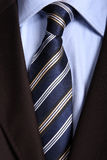 Tie. Blue striped tie, detail of a businessman suit Royalty Free Stock Photography