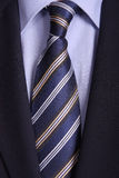 Tie. Blue striped tie, detail of a businessman suit Royalty Free Stock Image