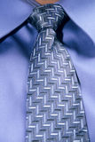 Tie. Close up of a blue tie knot and blue shirt on a person Stock Images