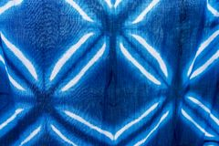 Tie batik dyeing tie batik indigo color or mauhom color on fabric. Background royalty free stock image