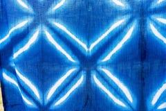 Tie batik dyeing tie batik indigo color or mauhom color on fabric. Background stock image