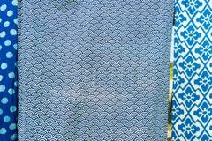 Tie batik dyeing tie batik indigo color or mauhom color on fabric. Background royalty free stock photo