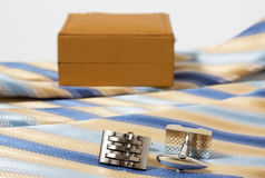 Tie, belt and cufflinks Stock Photography