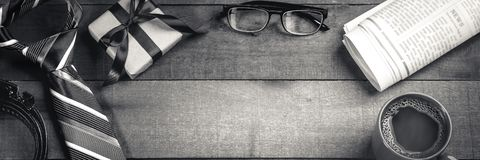 Tie, Belt, And Gift Box With Reading Glasses, Newspapers, And Coffee royalty free stock images