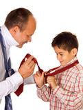 Tie binding. Help concept : father shows his son the tie binding royalty free stock photo