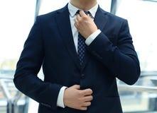 Tie. A businessman adjusting his tie stock images
