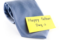 Tie with card tag write happy father day word. Blue neck tie with card tag write happy father day word on a white background Stock Image